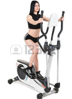 60412144-young-woman-doing-exercises-with-elliptical-cross-trainer-isolated-on-white-background